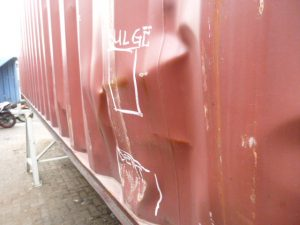 dented and scratched container